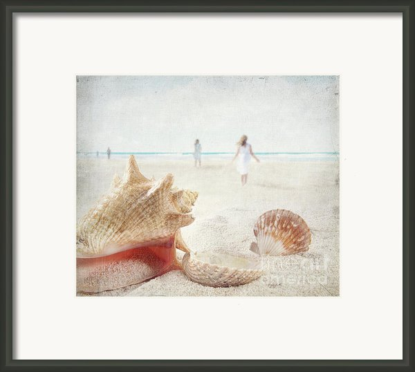 Beach Scene With People Walking And Seashells Framed Print By Sandra Cunningham