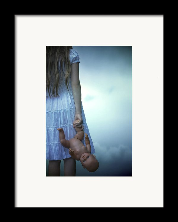 Girl With Baby Doll Framed Print By Joana Kruse