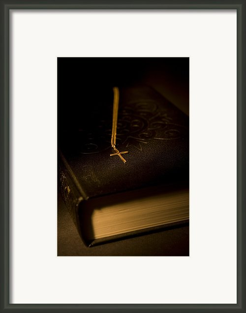 Gold Cross Pendant Resting On A Book Framed Print By Philippe Widling