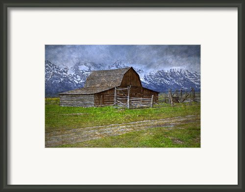 Grand Teton Iconic Mormon Barn Fence Spring Storm Clouds Framed Print By John Stephens
