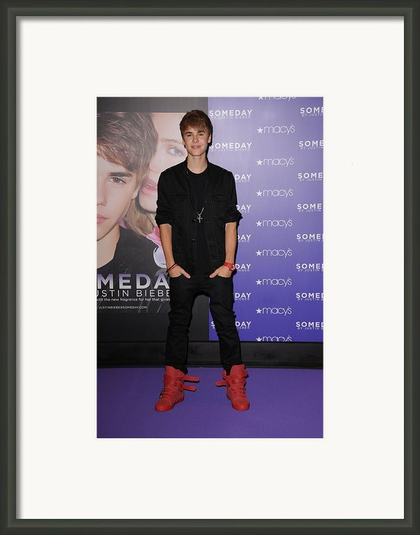 Justin Bieber At In-store Appearance Framed Print By Everett