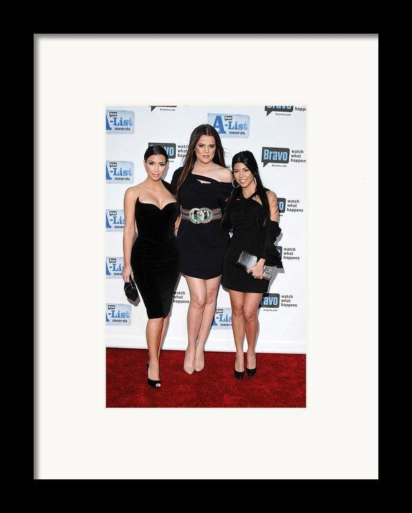 Kim Kardashian, Khloe Kardashian Framed Print By Everett