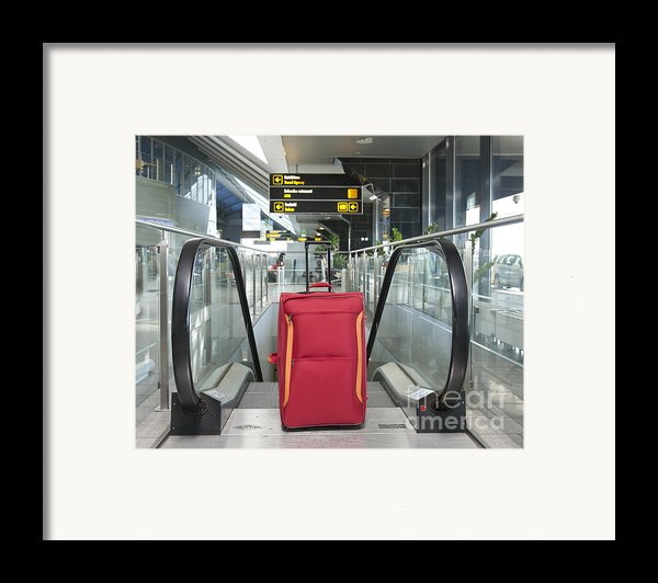 Luggage At The Top Of An Escalator Framed Print By Jaak Nilson