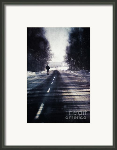 Man Walking On A Rural Winter Road Framed Print By Sandra Cunningham