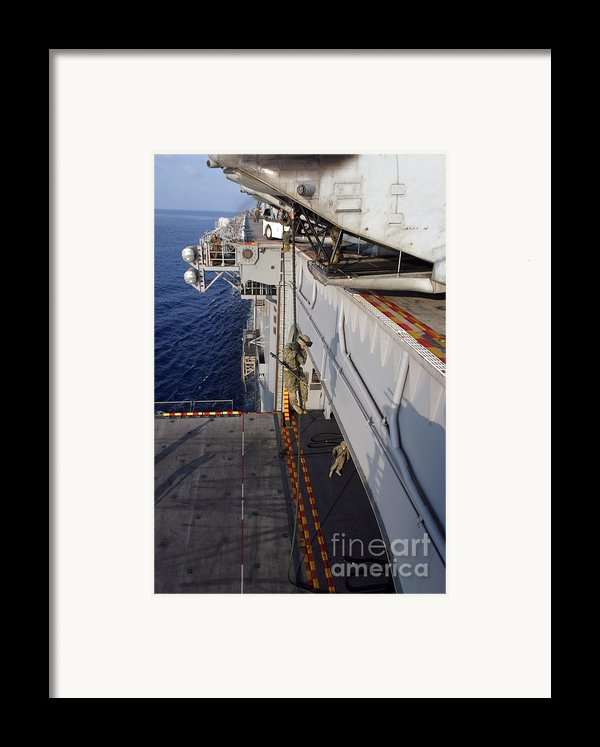 Marines And Sailors Fast-rope Framed Print By Stocktrek Images