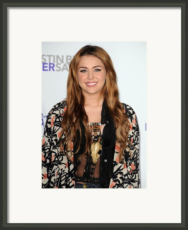 Miley Cyrus At Arrivals For Justin Framed Print By Everett