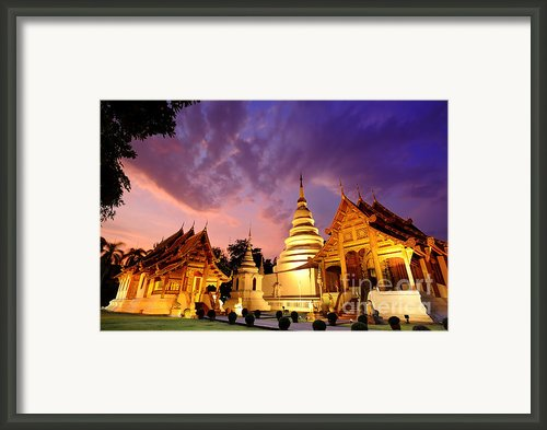 Phra Singh Temple Twilight Time Framed Print By Panupong Roopyai