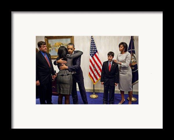 President And Michelle Obama Greet Framed Print By Everett