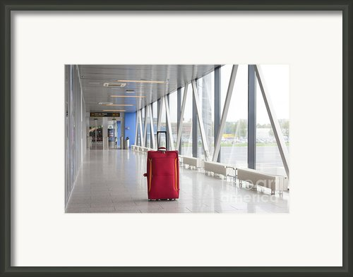 Rolling Luggage In An Airport Concourse Framed Print By Jaak Nilson