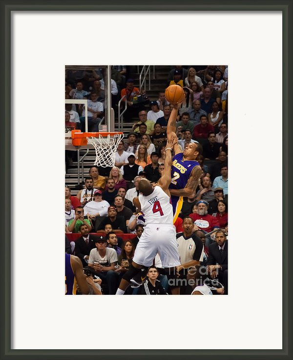 Slam Dunk Framed Print By Eddie Yerkish