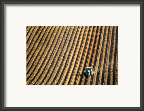 Tractor Plowing A Field Framed Print By John Short