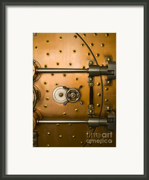 Tumbler On A Vault Door Framed Print By Adam Crowley