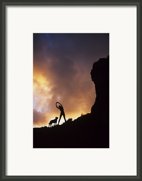 Woman Stretching On A Mountain Framed Print By Dana Edmunds - Printscapes
