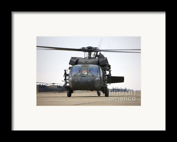 A Uh-60 Black Hawk Taxis Framed Print By Terry Moore
