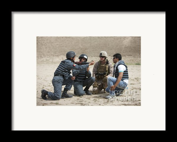 An Afghan Police Student Loads A Rpg-7 Framed Print By Terry Moore