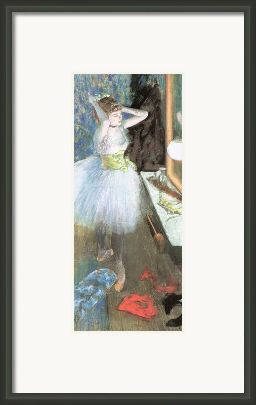 Dancer In Her Dressing Room Framed Print By Edgar Degas