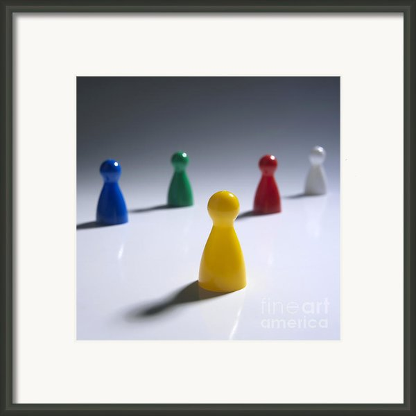 Game Pieces In Various Colours Framed Print By Bernard Jaubert