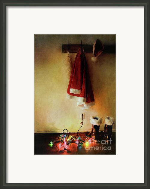 Santa Costume Hanging On Coat Hook With Christmas Lights Framed Print By Sandra Cunningham