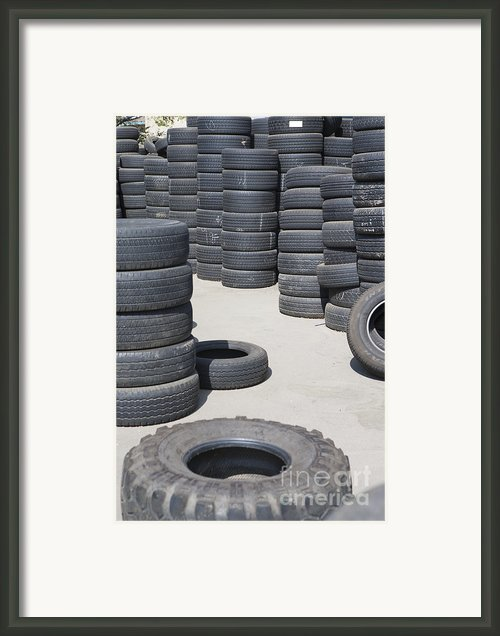 Stacks Of Used Tires Framed Print By Adam Crowley