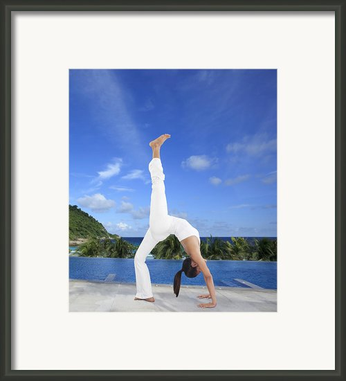 Woman Doing Yoga On The Beach Framed Print By Setsiri Silapasuwanchai