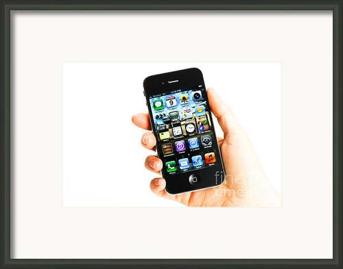 Hand Holding An Iphone Framed Print By Photo Researchers