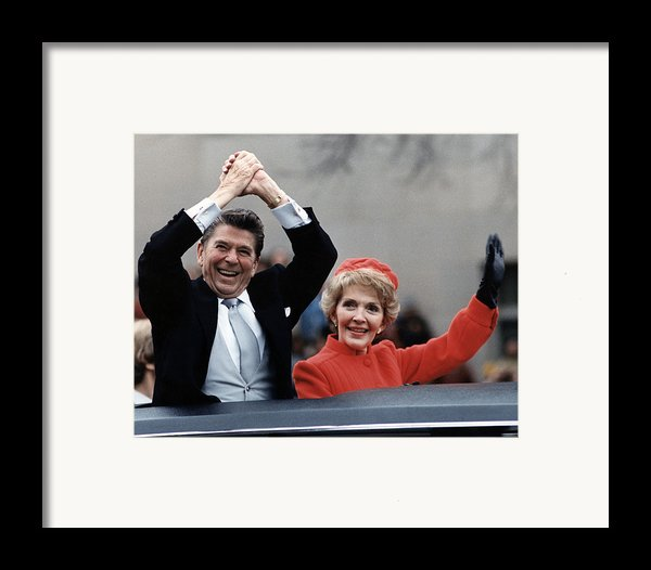 President Ronald Reagan And First Lady Framed Print By Everett