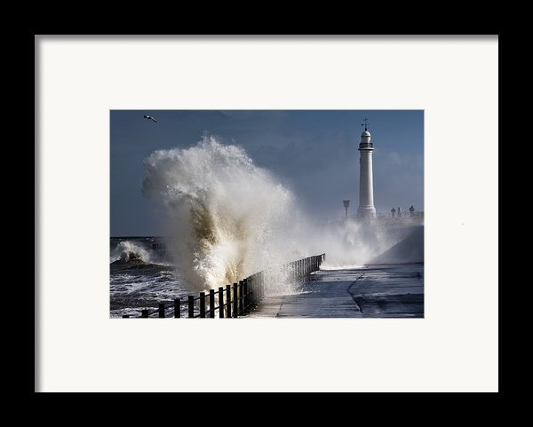 Waves Crashing By Lighthouse At Framed Print By John Short