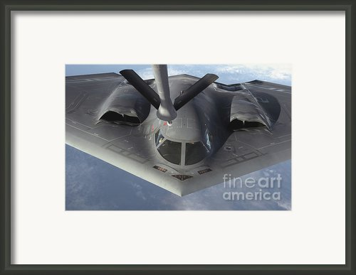 A B-2 Spirit Bomber Prepares To Refuel Framed Print By Stocktrek Images