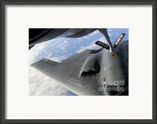 A B-2 Spirit Receives Fuel Framed Print By Stocktrek Images