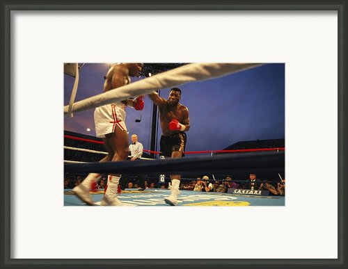 A Boxer Delivers A Punch Framed Print By Maria Stenzel