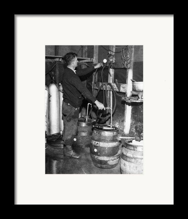 A Brewmeister Fills Kegs At A Bootleg Framed Print By Everett