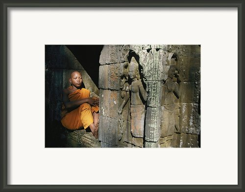 A Buddhist Monk Rest In An Alcove Framed Print By Paul Chesley