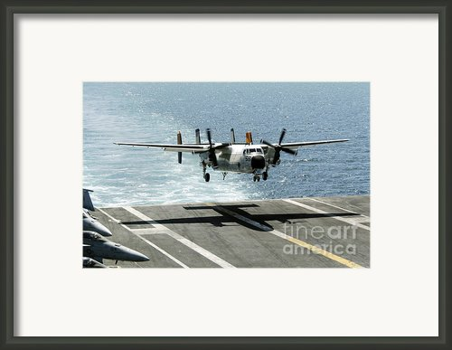 A C-2a Greyhound Prepares To Land Framed Print By Stocktrek Images