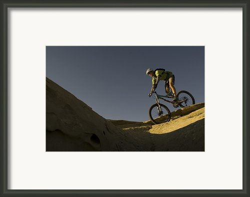 A Caucasian Man Mountain Biking Framed Print By Bobby Model