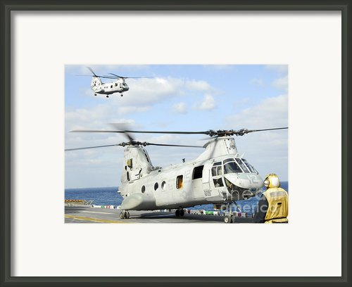A Ch-46e Sea Knight Helicopter Takes Framed Print By Stocktrek Images