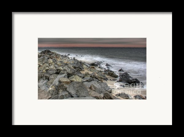 A Cold Day On A December Beach Framed Print By Lee Dos Santos