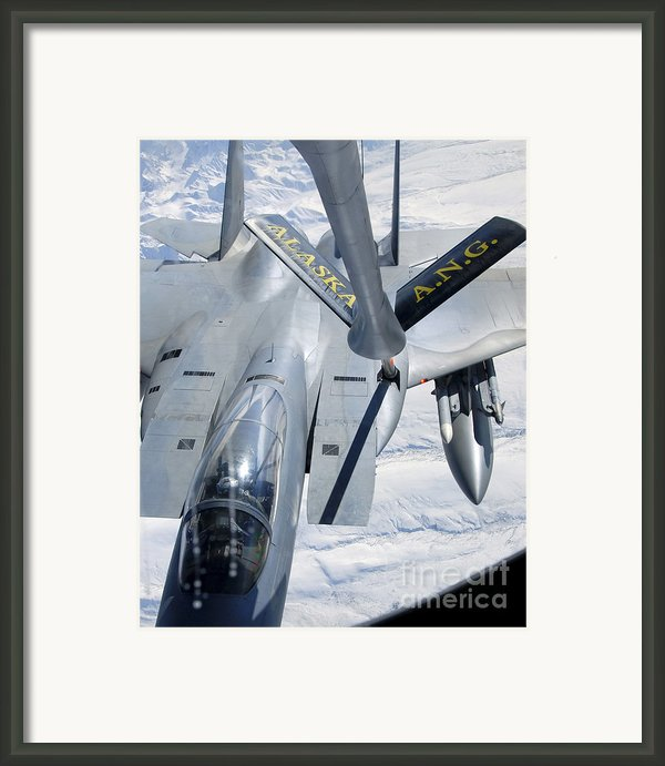 A F-15 Eagle Refuels Behind A Kc-135 Framed Print By Stocktrek Images