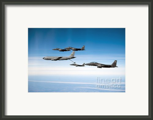 A F-15e Strike Eagle Is Refueled Framed Print By Stocktrek Images