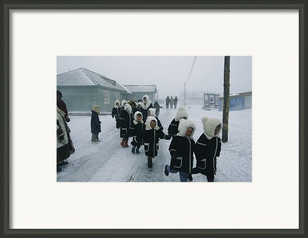 A Group Of School Children Run Framed Print By Maria Stenzel