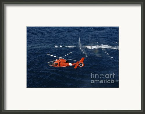 A Helicopter Crew Trains Off The Coast Framed Print By Stocktrek Images