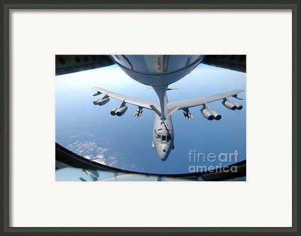 A Kc-135 Stratotanker Refuels A B-52 Framed Print By Stocktrek Images