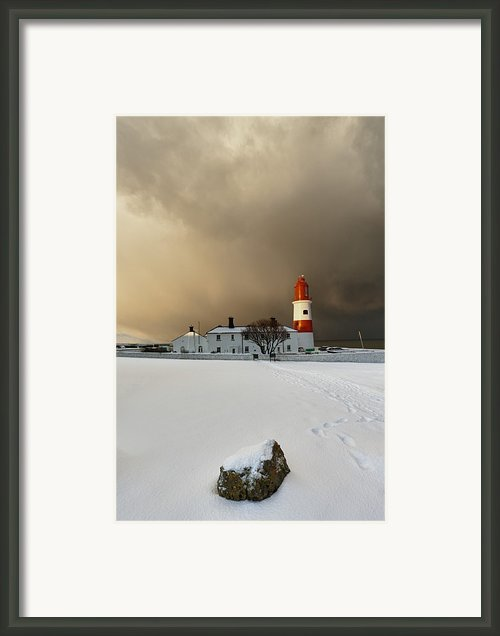 A Lighthouse And Building In Winter Framed Print By John Short