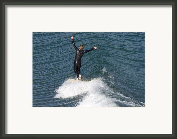 A Man Surfs A Longboard At Refugio Framed Print By Rich Reid