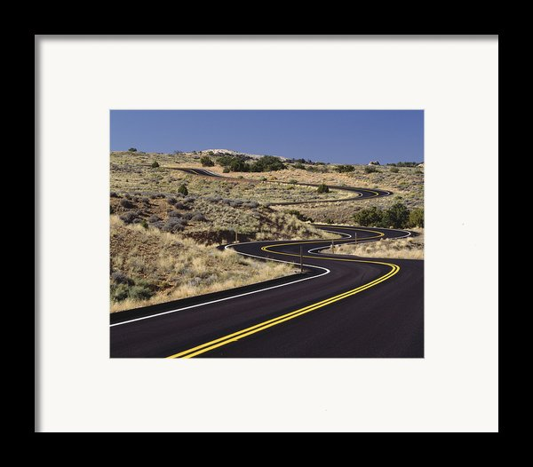 A Newly Paved Winding Road Up A Slight Framed Print By Greg Probst