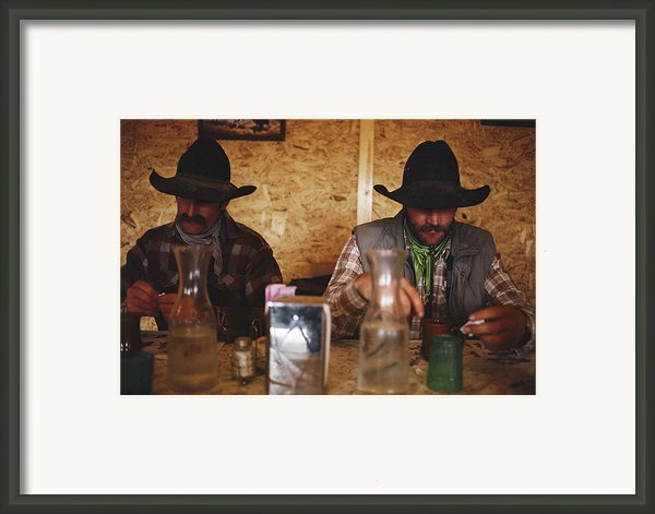 A Pair Of Cowboys Enjoy A Cup Of Coffee Framed Print By Joel Sartore