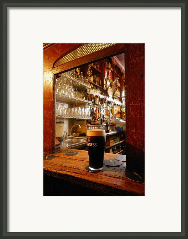 A Pint Of Dark Beer Sits In A Pub Framed Print By Jim Richardson