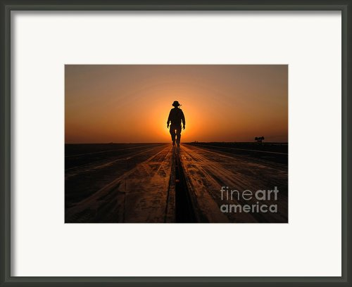 A Sailor Walks The Catapults Framed Print By Stocktrek Images