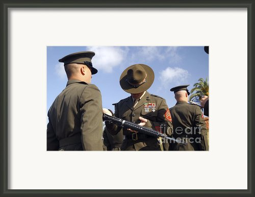 A Senior Drill Instructor Inspects Framed Print By Stocktrek Images