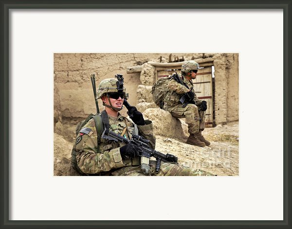 A Soldier Calls In Description Framed Print By Stocktrek Images