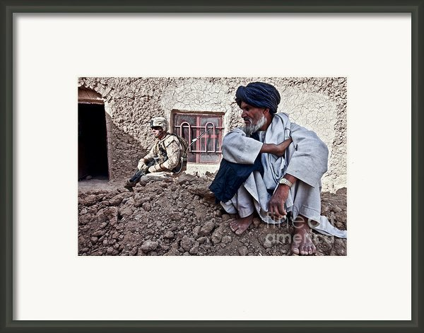 A Soldier Collects Information Framed Print By Stocktrek Images